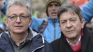 Pierre Lauret (à gauche) et Jean-Luc Mélenchon lors d'une manifestation à Paris, le 15 février 2015. (LOIC VENANCE / AFP)