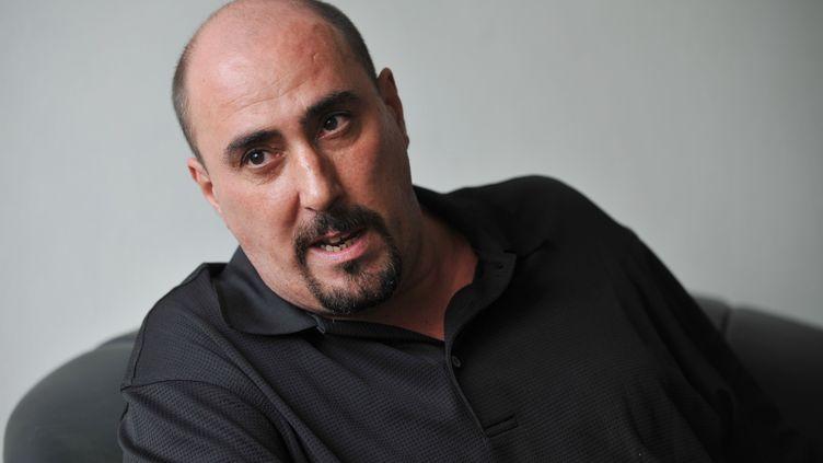 Serge Atlaoui accorde une interview à l'AFP le 25 septembre 2010 depuis la prison où il est détenu sur l'île de Nusakambangan, dans le sud de Java, en Indonésie. (BAY ISMOYO / AFP)