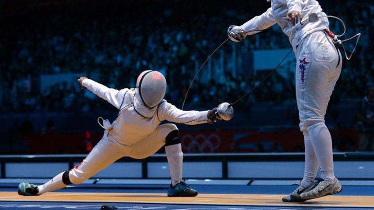 Laura Flessel a atteint les 8èmes de finale (TOSHIFUMI KITAMURA / AFP)