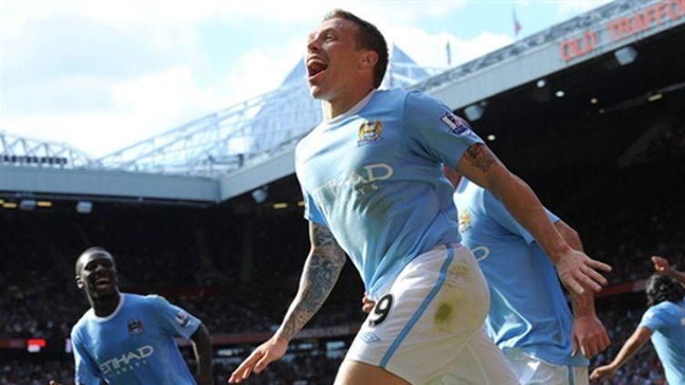 Craig Bellamy (Manchester City) laisse éclater sa joie (ANDREW YATES / AFP)
