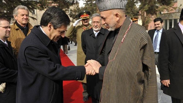 François Fillon rencontre le président afghan  Hamid Karzaï (11/02/2010) (AFP/MEHDI FEDOUACH)