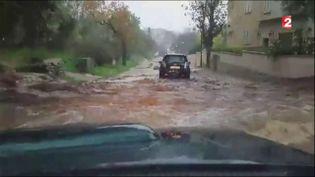 Capture d'écran d'une vidéo montrant des trombes d'eau s'abattre sur la Haute-Corse, le 24 novembre 2016. (FRANCE TELEVISIONS)