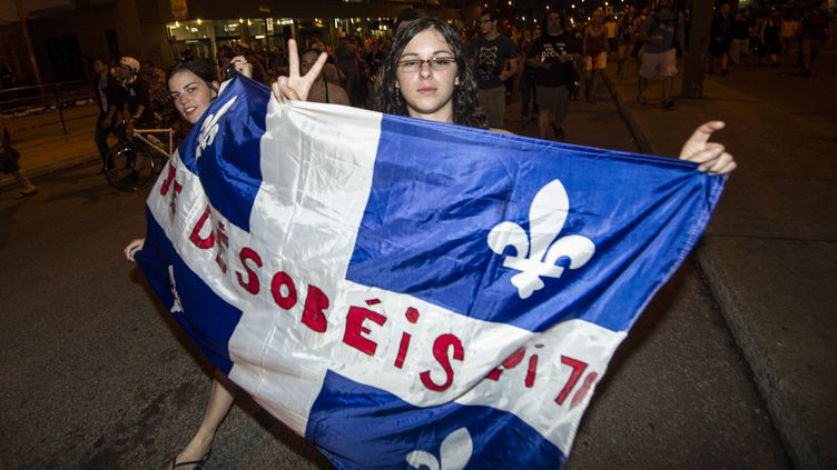 Manifestation à Montréal (Québec) contre la hausse des frais de scolarité à l'université, le 24 mai 2012. (ROGERIO BARBOSA / AFP)