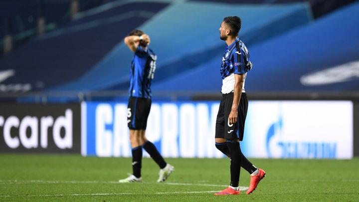 Les joueurs de l'Atalanta dépités après la victoire du PSG (DAVID RAMOS / POOL)