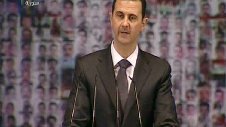 Bachar Al-Assad prononce un discours à l'Opéra de Damas (Syrie), le 6 janvier 2013. (SYRIAN TV / AFP)