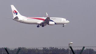 Un avion Malaysia Airlines à l'atterrissage à Kuala Lampur (Malaisie), le 21 juillet 2014. (AZHAR RAHIM / MAXPPP)
