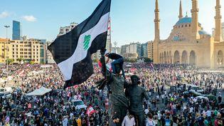 Manifestation contre le pouvoir politique libanais, le 8 août 2020, après les deux explosions qui ont ravagé la capitale du pays, quatre jours plus tôt. (- / AFP)