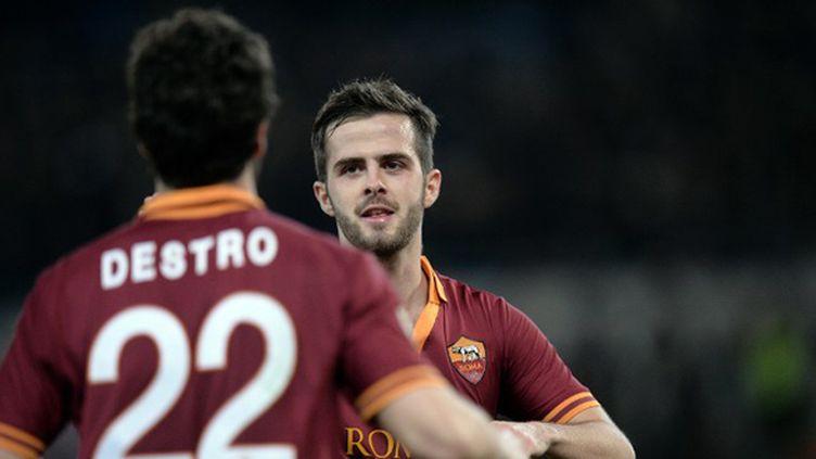 Destro et Pjanic ont régalé la Roma (FILIPPO MONTEFORTE / AFP)