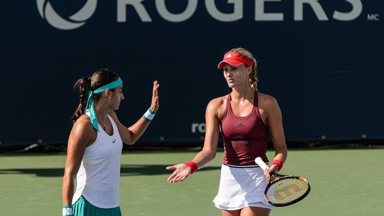 Les joueuses françaises Caroline Garcia et Kristina Mladenovic (MINAS PANAGIOTAKIS / GETTY IMAGES NORTH AMERICA)