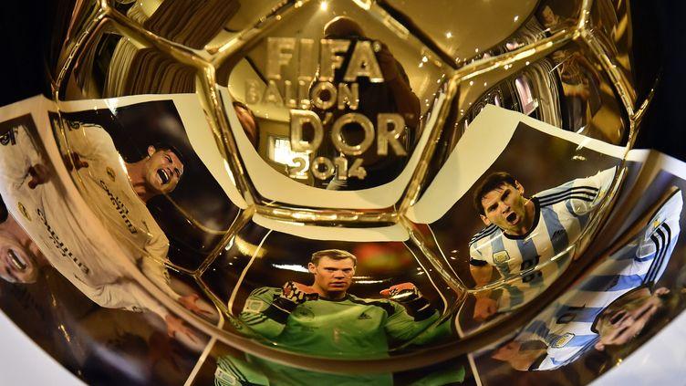 Les trois finalistes encore en course pour le Ballon d'Or : Ronaldo, Neuer et Messi (FRANCK FIFE / AFP)