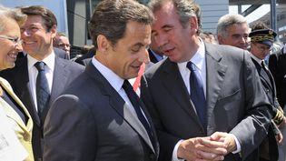 Nicolas Sarkozy et François Bayrou à Bordes (Pyrénées-Atlantiques), le 22 juin 2010. (PHILIPPE WOJAZER / REUTERS)