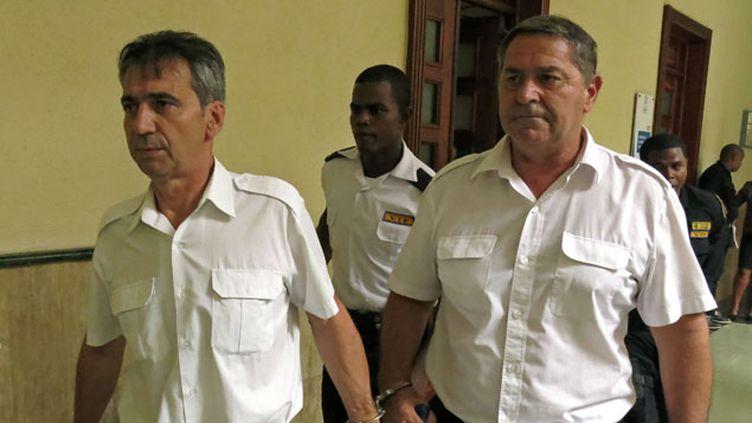 (Les deux pilotes en juin 2014, à Saint Domingue lors de leur jugement © SIPA - Ezequiel Abiu Lopez)