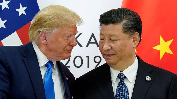 Donald Trump et Xi Jinping lors du G20 à Osaka (Japon), le 29 juin 2019. (KEVIN LAMARQUE / REUTERS)