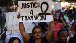 Manifestation à Sanford (Floride), le 13 juillet 2013, après l'annonce de l'acquittement du meurtrier présumé de Trayvon Martin. (SCOTT OLSON / GETTY IMAGES NORTH AMERICA)