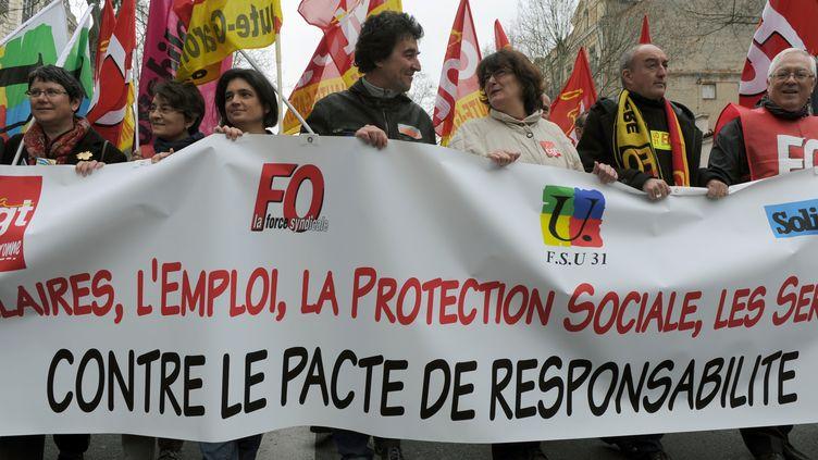 Des manifestants défilent contre le pacte de responsabilité, le 18 mars 2014, à Toulouse (Haute-Garonne). (ERIC CABANIS / AFP)