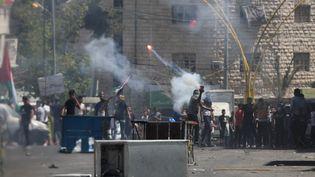 Dix Palestiniens ont été tués en Cisjordanie occupée, le 13 mai 2021, dans plusieurs heurts avec l'armée israélienne en marge d'une vaste journée de manifestations de colère. (MAMOUN WAZWAZ / ANADOLU AGENCY / AFP)