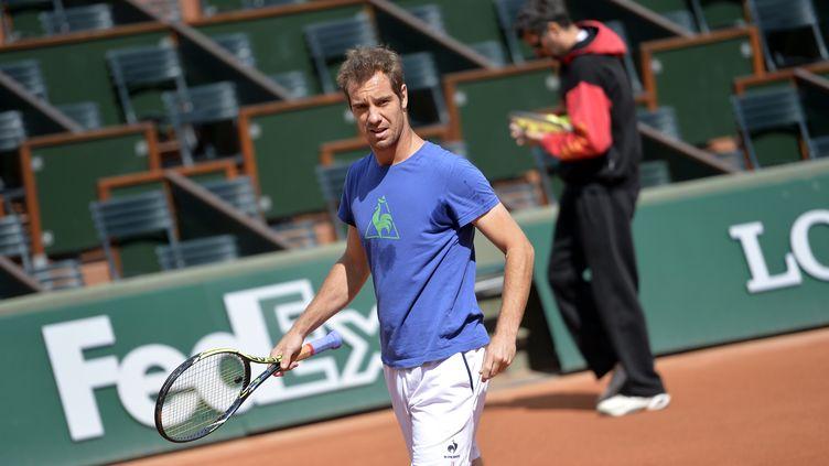 Le joueur de tennis français Richard Gasquet à l'entrainement, mercredi 20 mai, à Roland-Garros (Paris). (MIGUEL MEDINA / AFP)