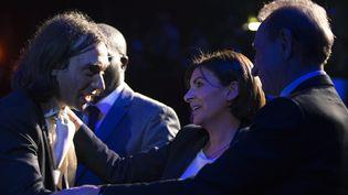 Cédric Villani et Anne Hidalgo lors d'un meeting, le 13 mars 2014 à Paris. (JOEL SAGET / AFP)