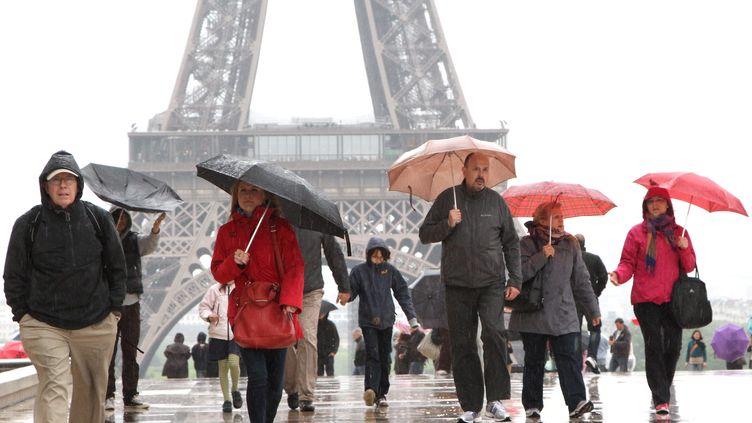 Paris sous la pluie le 20 mai 2013 ( MAXPPP)