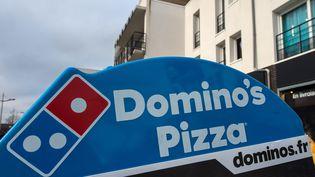 La franchise de pizzerias Domino's Pizza a obtenu les droits de la Ligue 2 pour la période 2016-2020. (PHILIPPE HUGUEN / AFP)