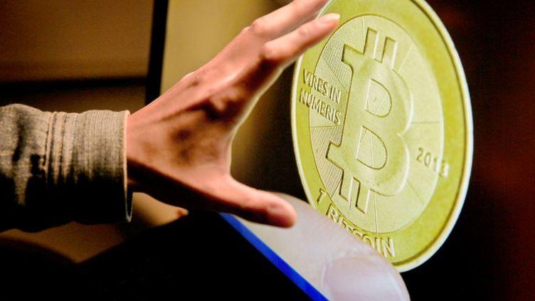 """Sur la plateforme """"The Company', les internautes pouvaient acquérir des bitcoins sans décliner leur identité. (BENJAMIN GZ / IMAGINECHINA / AFP)"""