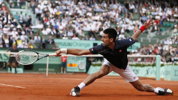 Djokovic ne lâche rien pour gagner son premier titre à Roland-Garros (KENZO TRIBOUILLARD / AFP)
