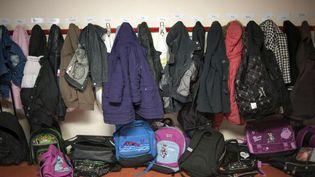 Dans les couloirs de l'école primaire de Brie-Comte-Robert (Seine-et-Marne) le 21 mai 2012. (FRED DUFOUR / AFP)
