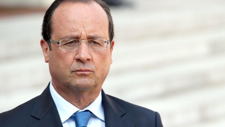François Hollande lors d'une conférence de presse avec le président du Conseil national syrien, la principale coalition d'opposition syrienne,à l'Elysée, à Paris, le 29 août 2013. (KENZO TRIBOUILLARD / AFP)