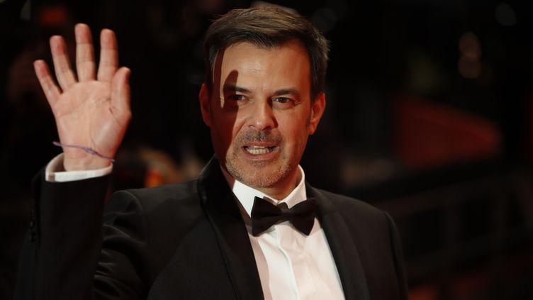 """Le réalisateur François Ozon, à son arrivée pour la première du film """"Grâce à Dieu"""", pendant la Berlinale, le 8 février 2019 à Berlin (Allemagne). (ODD ANDERSEN / AFP)"""