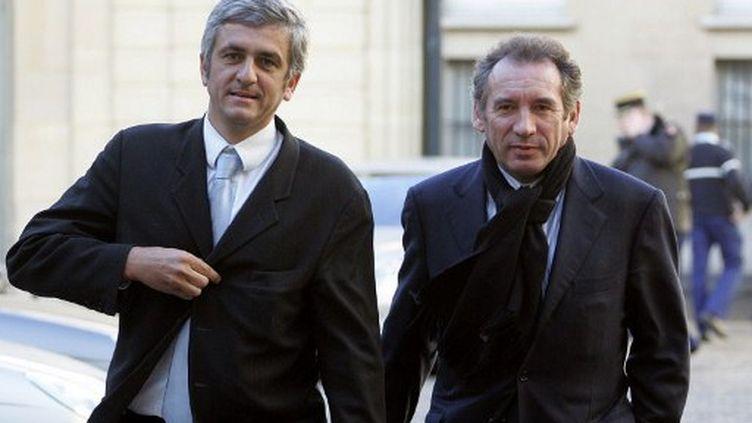 Hervé Morin et François Bayrou arrivent ensemble à Matignon, le 28 février 2006. (AFP - Jack Guez)