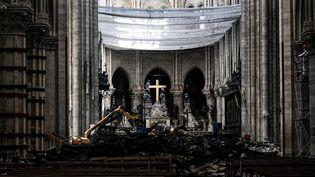 L'intérieur de la cathédrale Notre-Dame de Paris, le 15 mai 2019, un mois après un violent incendie ayant ravagé la flèche et la toiture de l'édifice. (PHILIPPE LOPEZ / POOL / AFP)