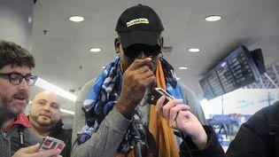 L'ancien basketteur Dennis Rodman, en escale à Pékin (Chine), jeudi 19 décembre. (WANG ZHAO / AFP)