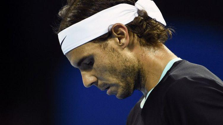 Rafael Nadal est touché au pied droit  (FRED DUFOUR / AFP)