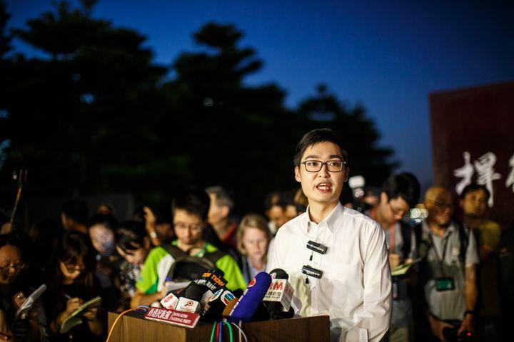 Andy Chan, 25 ans, l'un des leaders de la contestation contre Pékin (Chine), s'exprime lors de la manifestation réclamant l'indépendance de Hong Kong, vendredi 5 août 2016. (ANTHONY WALLACE / AFP)
