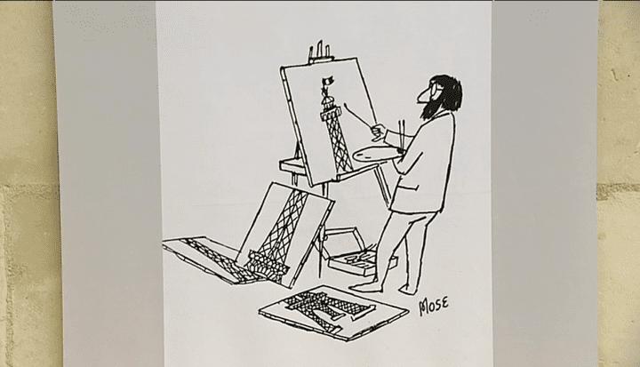 Le peintre de Mose a bien du mal à peindre la totalité de la Tour Eiffel.  (France 3 / Culturebox)