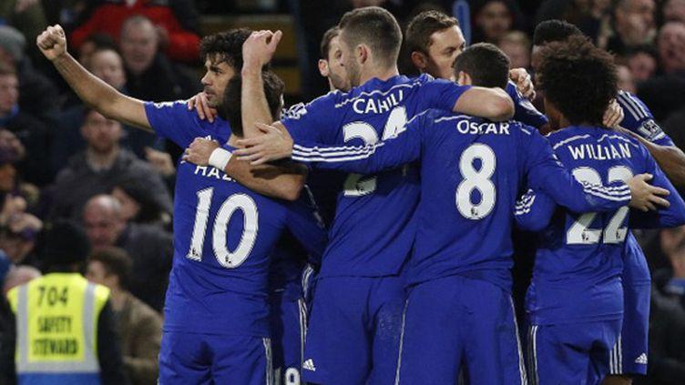 L'équipe de Chelsea célèbre sa victoire face à Hull City (JUSTIN TALLIS / AFP)