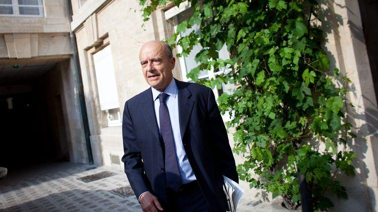 Alain Juppé, à la sortie du bureau politique de l'UMP à l'Assemblée nationale, le 20 juin 2012. (MARLENE AWAAD / MAXPPP)