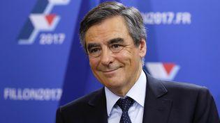 François Fillon réagit après sonarrivée en tête au premier tour de la primaire à droite, le 20 novembre 2016 à Paris. (THOMAS SAMSON / AFP)