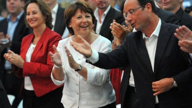 De gauche à droite : Royal, Aubry et Hollande en août 2011 à La Rochelle (AFP - PIERRE ANDRIEU)
