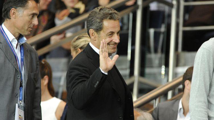 Nicolas Sarkozy le 31 août 2014 au Parc des princes, à Paris, lors du match entre lePSG et l'ASSaint-Etienne. (JEAN-MARIE HERVIO / DPPI MEDIA / AFP)