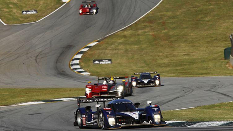 Peugeot et Audi en bagarre sur le circuit de Road Atlanta lors du Petit Le Mans (JEAN MICHEL LE MEUR / JEAN MICHEL LE MEUR)