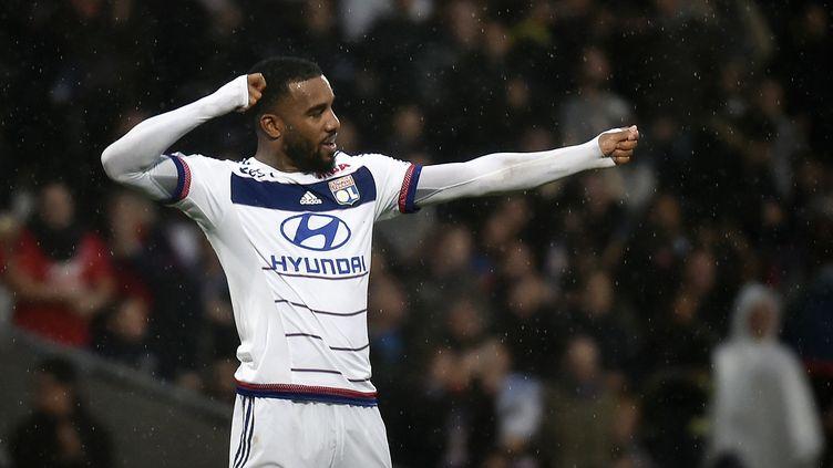Alexandre Lacazette, l'attaquant de Lyon, buteur face à Reims. (JEFF PACHOUD / AFP)