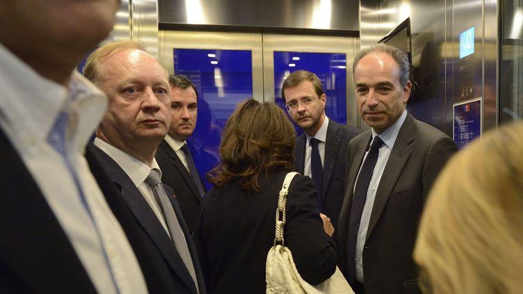 (de g à D),Eric Cesari, directeur général adjoint de l'UMP, Guillaume Bataille, Jérôme Lavrilleux et Jean-François Copé, au siège du parti à Paris, le 30 mars 2014. ( WITT / SIPA)