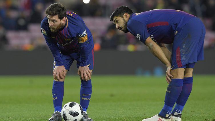 Messi et Luis Suarez (LLUIS GENE / AFP)