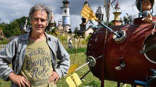 Robert Coudray a imaginé un village fantaisiste qu'il a construit de toutes pièces à Lizio dans le Morbihan  (FRED TANNEAU / AFP)