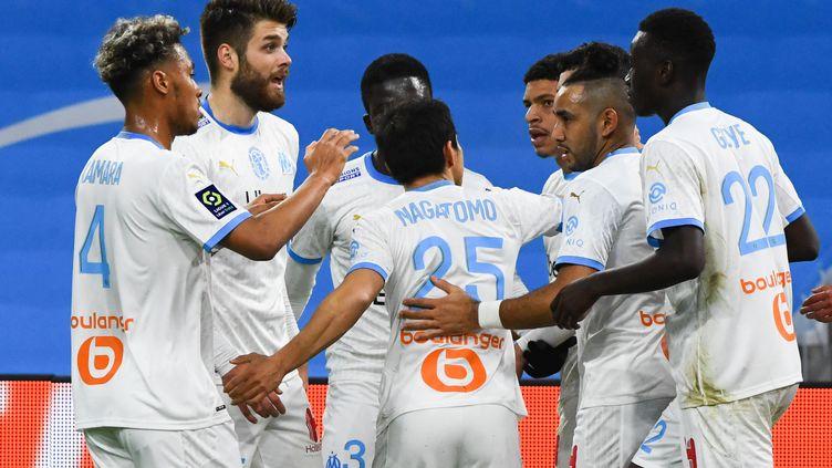 Les joueurs de l'Olympique de Marseille.  (CLEMENT MAHOUDEAU / AFP)