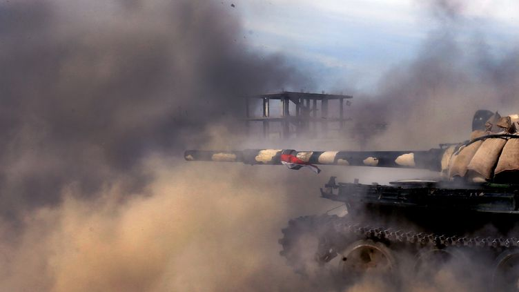Un tank de l'armée syrienne, dans la ville d'Al-Qusayr, le 23 mai 2013. ( AFP / PHOTNONSTOP)