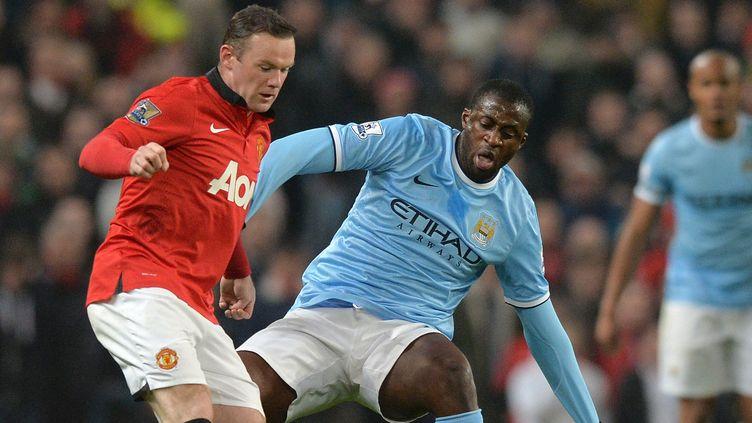 Wayne Rooney, meilleur buteur de l'histoire du derby, devrait débuter la partie. (PAUL ELLIS / AFP)