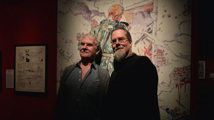 """Hermann et son fils Yves H. le jour de l'inauguration de l'exposition """"Hermann : le naturaliste de la bande dessinée"""".  (S.Lefèvre / Photopqr / Populaire du Centre / MAXPPP)"""