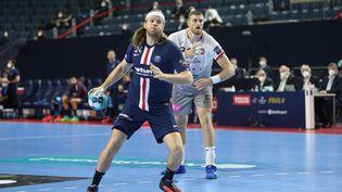 La Parisien Mikkel Hansen contre Veszprem lors du dernier Final Four de la Ligue des champions, à Cologne, le 29 décembre 2020. (LAURENT LAIRYS / LAURENT LAIRYS)